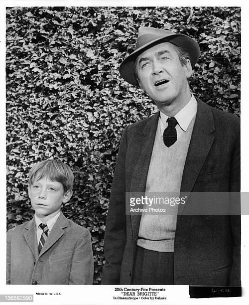 Bill Mumy and James Stewart standing together in a scene from the film 'Dear Brigitte' 1965