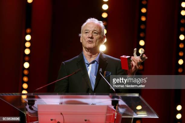 Bill Murray accepts the Silver Bear for Best Director Wes Anderson for 'Isle of Dogs' on stage at the closing ceremony during the 68th Berlinale...
