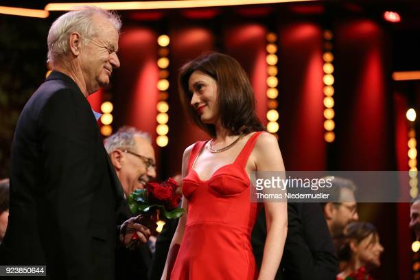 Bill Murray and Irmena Chichikova are seen on stage at the closing ceremony during the 68th Berlinale International Film Festival Berlin at Berlinale...