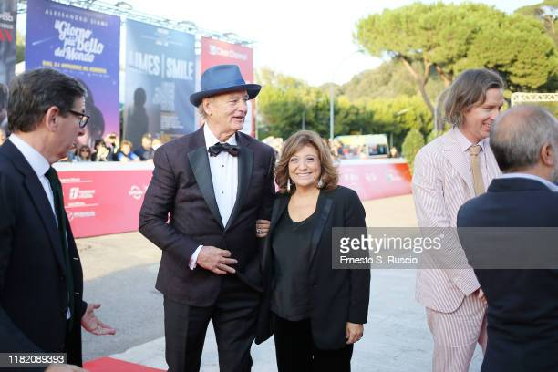Bill Murray and Laura Delli Colli walk a red carpet during the 14th Rome Film Festival on October 19 2019 in Rome Italy