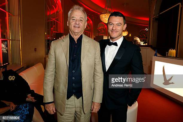 Bill Murray and Luke Evans arrive at the GQ Men of the year Award 2016 at Komische Oper on November 10 2016 in Berlin Germany