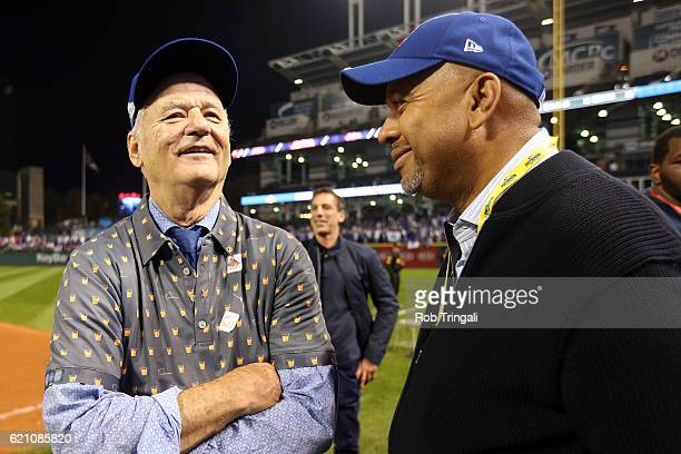 Bill Murray and Michael Wilbon speak on the field after the Chicago Cubs defeated the Cleveland Indians in Game 7 of the 2016 World Series at...