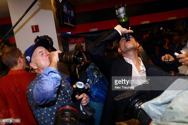 Bill Murray and President of Baseball Operations Theo Epstein of the Chicago Cubs celebrate in the clubhouse after defeating the Cleveland Indians in...