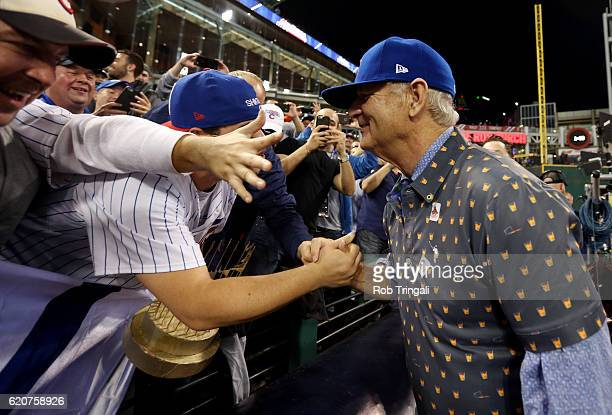 Bill Murray celebrates with Chicago Cubs fans in the stands after the Cubs defeated the Cleveland Indians in Game 7 of the 2016 World Series at...