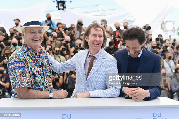 """Bill Murray, Director Wes Anderson and Adrian Brody attend the """"The French Dispatch"""" photocall during the 74th annual Cannes Film Festival on July..."""