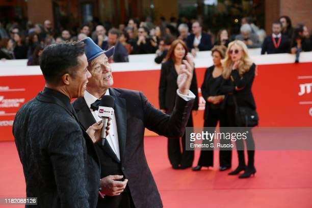 Bill Murray is interviewed by Livio Beshir on a red carpet during the 14th Rome Film Festival on October 19 2019 in Rome Italy