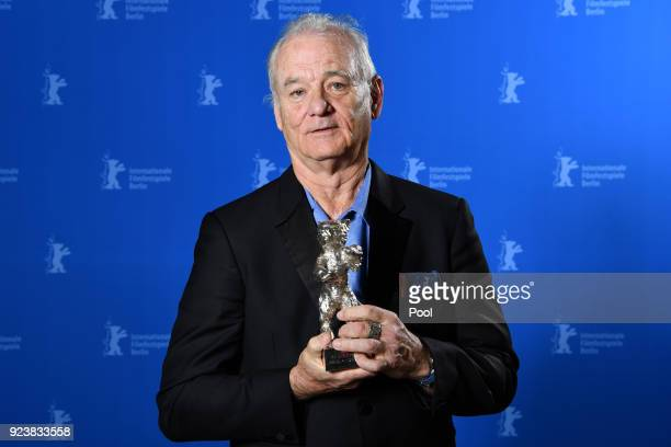 Bill Murray poses with the award he accepted for Wes Anderson winner of the Silver Bear for Best Director for 'Isle of Dogs' at the Award Winners...