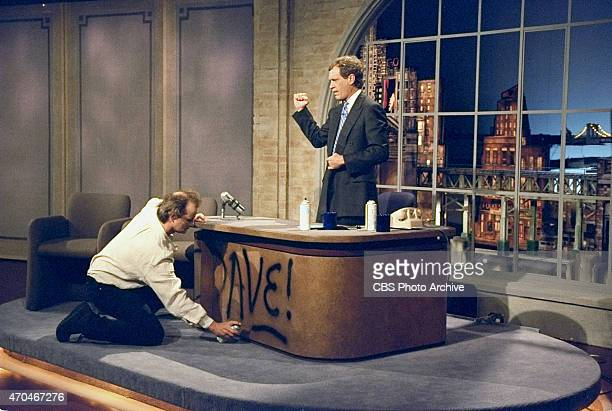 Bill Murray spray paints Dave's desk on the first taping of the Late Show with David Letterman August 30 1993 on the CBS Television Network This...