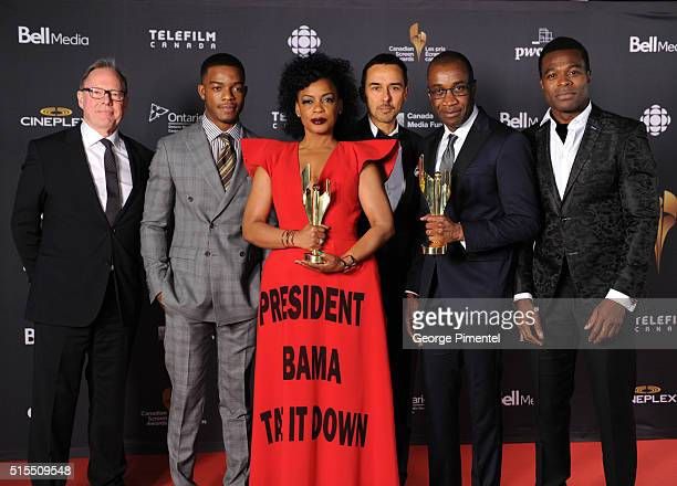 Bill Niven, Stephan James, Aunjanue Ellis, Damon D'Oliveira, Clement Virgo and Lyriq Bent pose in the press room at the 2016 Canadian Screen Awards...
