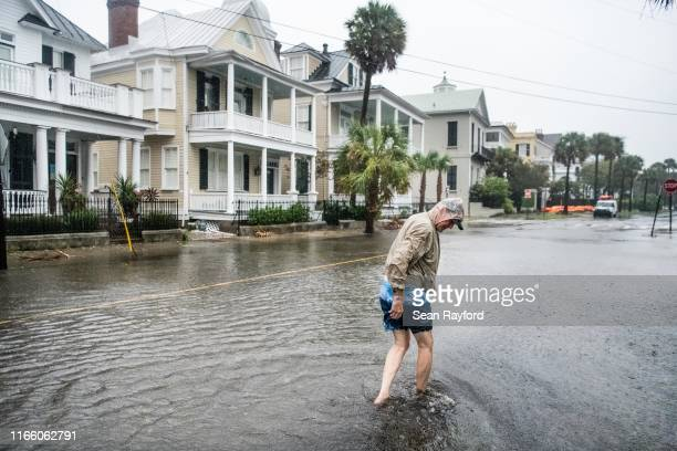 Bill Olesner walks down South Battery St while cleaning debris from storm drains on September 5 2019 in Charleston South Carolina Hurricane Dorian is...