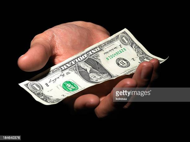 bill on the palm - one dollar bill stock pictures, royalty-free photos & images