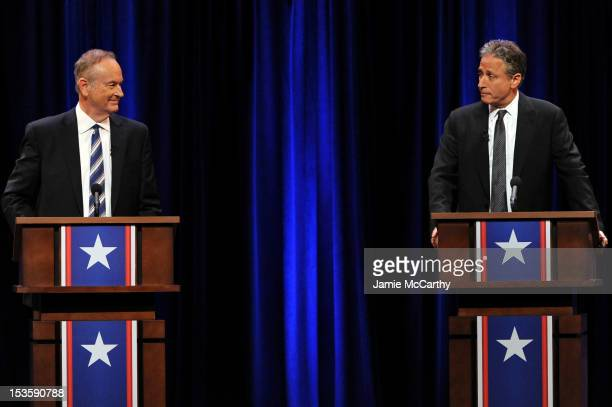 Bill O'Reilly and Jon Stewart onstage at O'Reilly Vs Stewart 2012 The Rumble In The AirConditioned Auditorium at Lisner Auditorium at George...