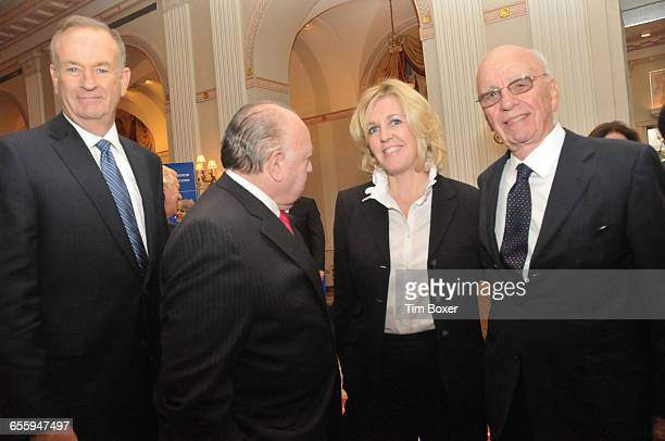 Bill O'Reilly poses for a photo while Roger Ailes is more interested in his wife Elizabeth standing with Rupert Murdoch at an AntiDefamation dinner...