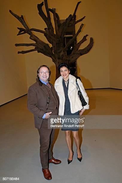 Bill Pallot and his companion Dina Daswani Lloyd attend the 'Bentu' Exhibition at the Louis Vuitton Foundation Coorganized with the 'Ullens Center...