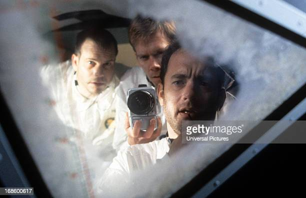 Bill Paxton Kevin Bacon and Tom Hanks looking out ship window in a scene from the film 'Apollo 13' 1995