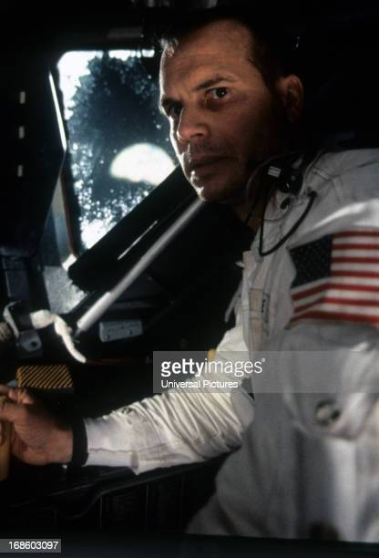 Bill Paxton sitting in ship in a scene from the film 'Apollo 13' 1995