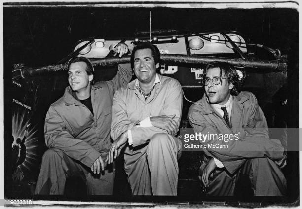 Bill Paxton Wayne Newton and Judd Nelson pose for a photo at a party for the premiere of their film The Dark Backward in July 1991 in New York City...