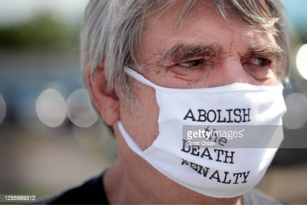 Bill Pelke of Anchorage, Alaska expresses his opposition to the death penalty during a protest near the Federal Correctional Complex where Daniel...