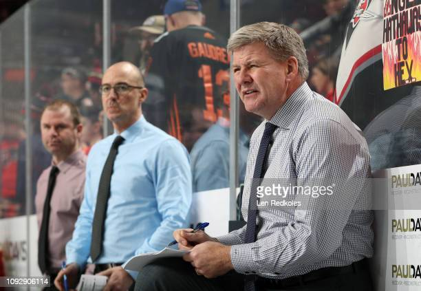 Bill Peters head coach of the Calgary Flames looks on from the bench during warmups against the Philadelphia Flyers on January 5 2019 at the Wells...