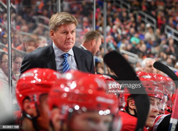 Bill Peters of the Carolina Hurricanes watches play from the bench during the preseason game against the Edmonton Oilers on September 25 2017 at...