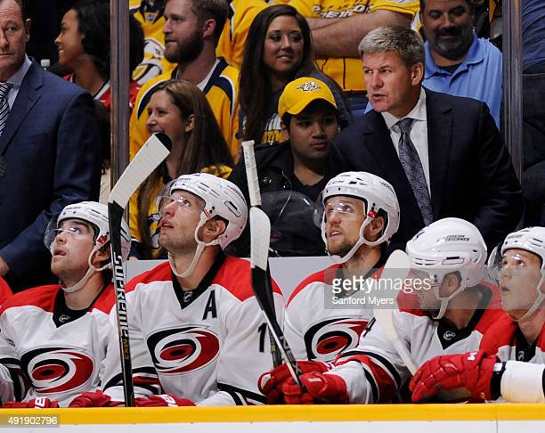 Bill Peters of the Carolina Hurricanes watches the action against the Nashville Predators at Bridgestone Arena on October 8 2015 in Nashville...