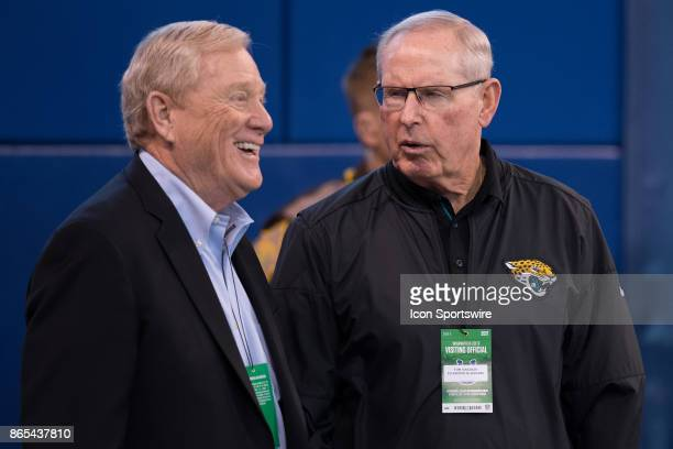 Bill Polian and Tom Coughlin talk on the field before the NFL game between the Jacksonville Jaguars and Indianapolis Colts on October 22 at Lucas Oil...