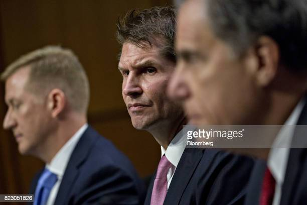 Bill Priestap assistant director of the counterintelligence division with the Federal Bureau Of Investigation center listens during a Senate...