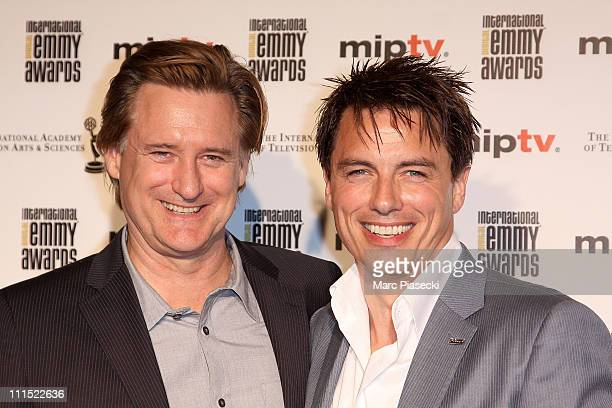 Bill Pullman and John Barrowman attend the MIPTV 2011 Opening Cocktail Digital Emmy Awards at Carlton hotel on April 4 2011 in Cannes France