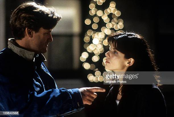 Bill Pullman and Sandra Bullock in a scene from the film 'While You Were Sleeping', 1995.