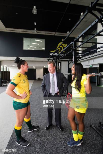 Bill Pulver speaks to Rugby Australia athletes Mollie Gray and Mahalia Murphy during the opening of the Rugby Australia Building on October 27 2017...