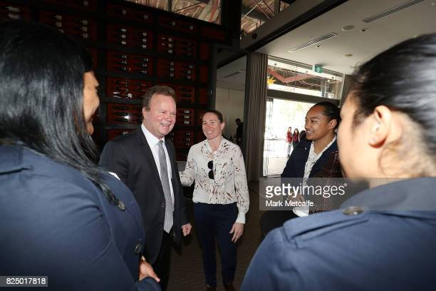 Bill Pulver talks to Wallaroos players during the Australian Wallaroos team farewell at View By Sydney on August 1 2017 in Sydney Australia The...