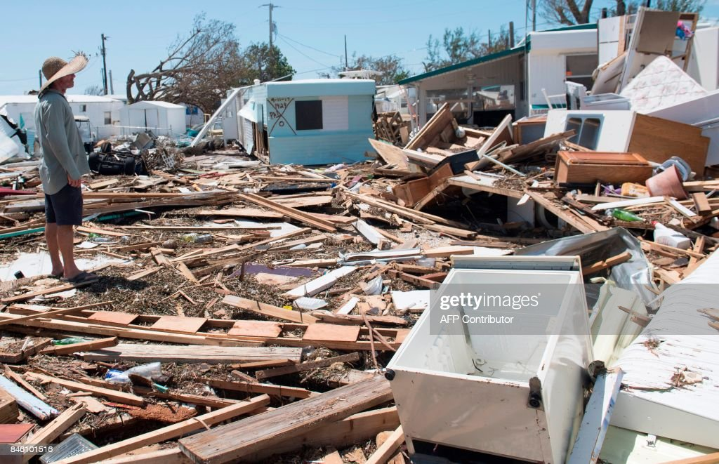 Bill Quinn surveys the damage caused to his trailer home from Hurricane Irma at the Seabreeze Trailer Park in Islamorada, in the Florida Keys, September 12, 2017. /
