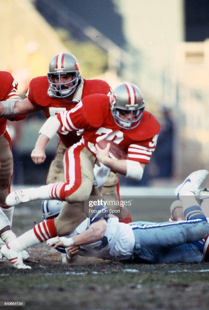 Bill Ring of the San Francisco 49ers carries the ball against the Dallas Cowboys during the NFC Conference Championship Game January 10 1982 at...