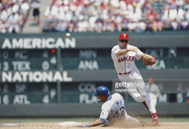Bill Ripkin Short Stop for the Texas Rangers throws to home as Bill Goodwin of the Kansas City Royals tries to slide into base during their Major...