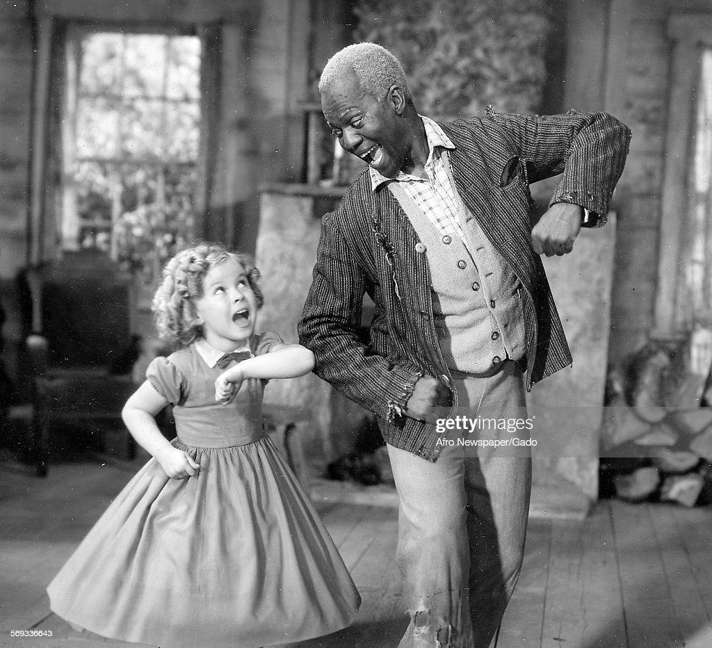 Bill Robinson, aka Mr Bojangles, on a film set with child actress Shirley Temple, January 23, 1936.
