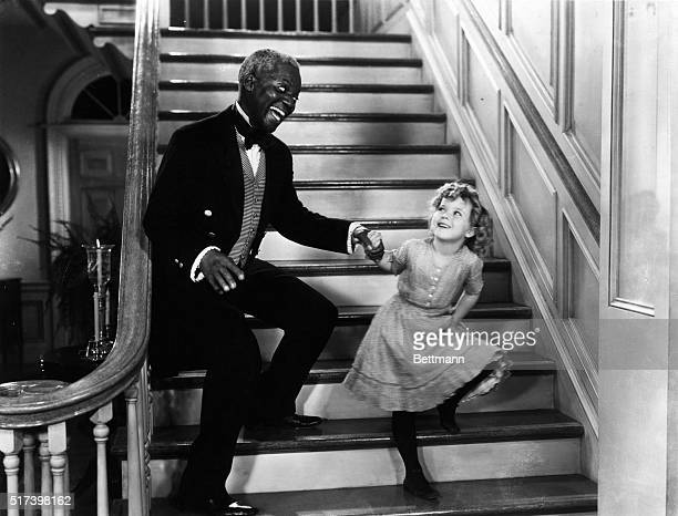 Bill Robinson and Shirley Temple holding hands descending staircase Undated movie still BPA2# 3199