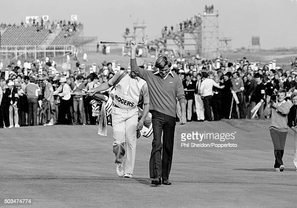 Bill Rogers of the United States acknowledges the crowd on the 18th fairway en route to winning the British Open Golf Championship held at the Royal...