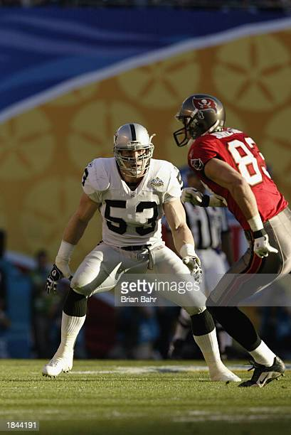Bill Romanowski of the Oakland Raiders eyes wide receiver Joe Jurevicius of the Tampa Bay Buccaneers as he runs a pattern during Super Bowl XXXVII on...
