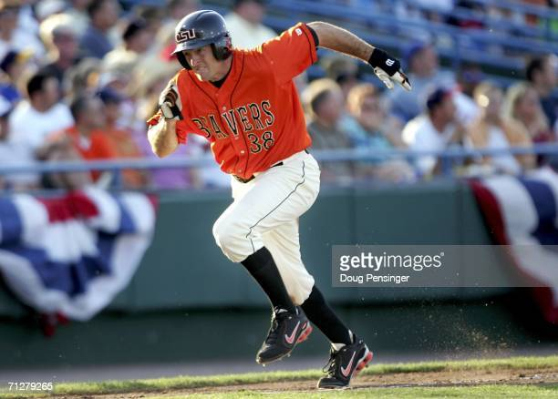 Bill Rowe of the Oregon State Beavers heads for home to score the first run of the game as the Beavers defeated the Rice Owls 20 to advance to the...