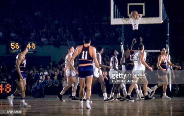Bill Russell and K.C. Jones of the Boston Celtics along with Wilt Chamberlain of the Philadelphia Warriors wait for the rebound during an NBA game on...