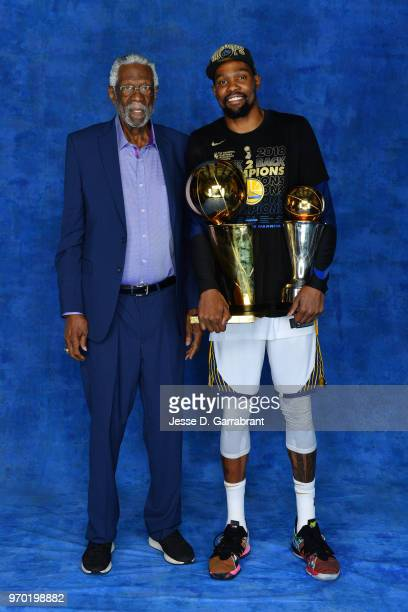 Bill Russell and Kevin Durant of the Golden State Warriors pose for a portrait with the Larry O'Brien Championship trophy and the Bill Russell Finals...