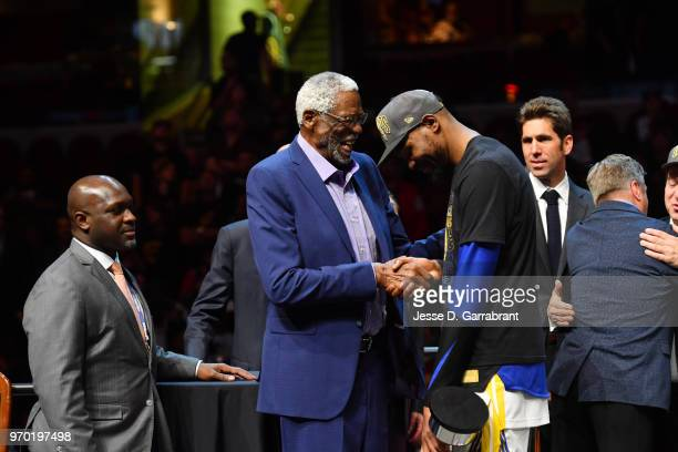 Bill Russell exchanges handshakes with Kevin Durant of the Golden State Warriors after Durant received the Bill Russell Finals MBP Trophy by...
