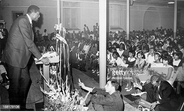Bill Russell is the main speaker during Freedom Graduation at Patrick T. Campbell Jr. High School in Roxbury, June 20, 1966.
