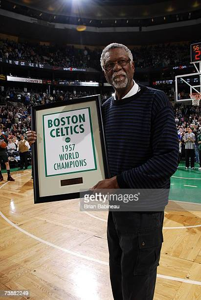 Bill Russell of the 1957 Boston Celtics receives a banner of the 1957 Boston Celtic champions during halftime against the Milwaukee Bucks on April 13...