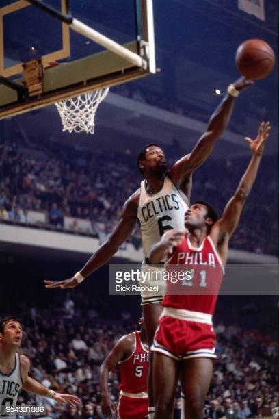 Bill Russell of the Boston Celtics blocks a shot against the Philadelphia 76ers circa 1964 at the Boston Garden in Boston Massachusetts NOTE TO USER...
