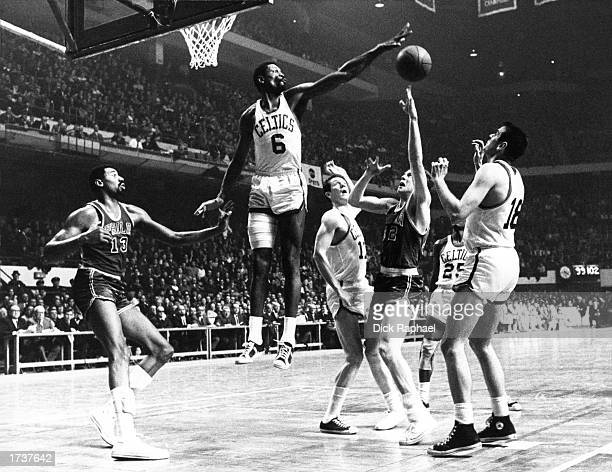 Bill Russell of the Boston Celtics goes for a block against the Philadelphia 76ers during the 1964 NBA Game at Boston Garden in Boston Massachusetts...