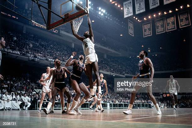 Bill Russell of the Boston Celtics goes for a layup against the Philadelphia 76ers during the 1970 season NBA game at the Boston Garden in Boston...