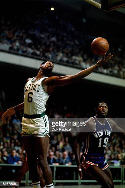 Bill Russell of the Boston Celtics grabs the rebound against Willis Reed of the New York Knicks circa 1970's at the Boston Garden in Boston,...