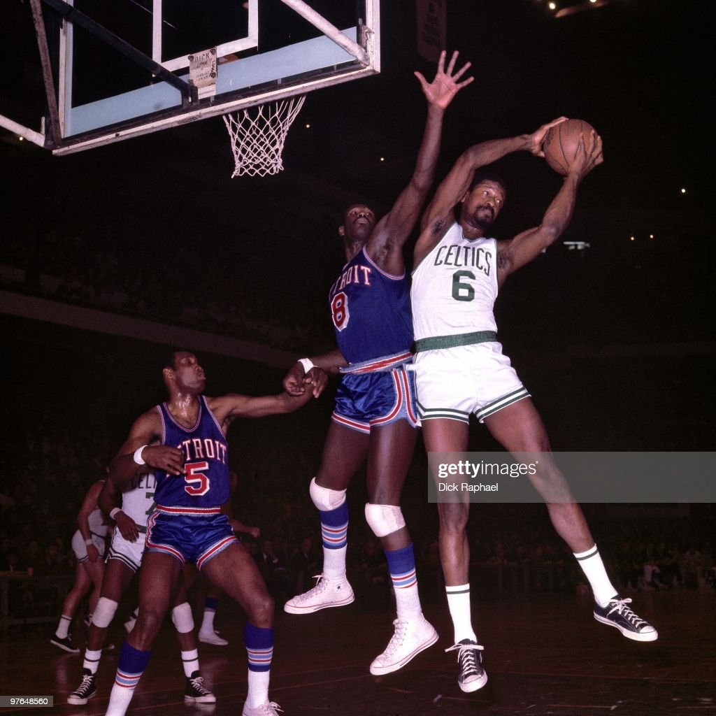 Bill Russell #6 of the Boston Celtics rebounds against Bob Warlick #8 of the Detroit Pistons during a game played in 1967 at the Boston Garden in Boston, Massachusetts.