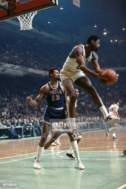 ca947fe29 Bill Russell of the Boston Celtics rebounds against Wilt Chamberlain of the  Philadelphia 76ers during a